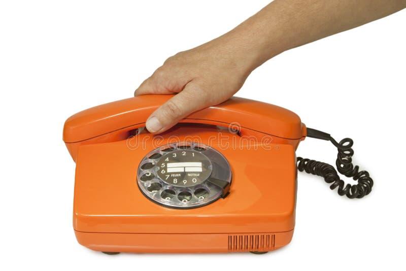 Altes orange Telefon lizenzfreie stockfotografie
