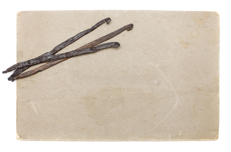 Altes Papier mit den Vanillebohnen getrennt stockbild