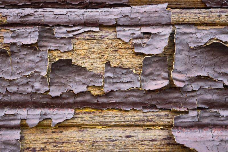 Altes schmutziges Öl lackiert verdünnt flochene schuppige hölzerne Farbe Wand braun Schokolade gelb innen als Design lizenzfreie stockfotografie