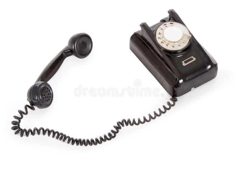 Altes schwarzes Telefon getrennt über Weiß stockfoto
