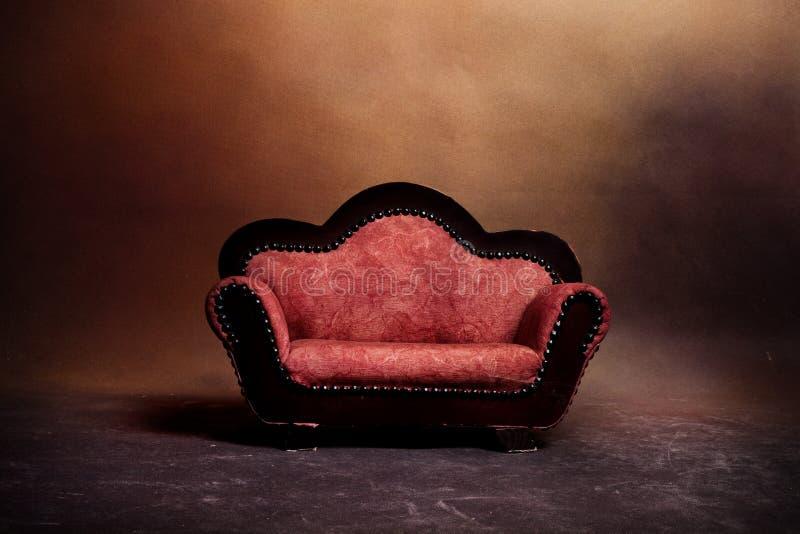 Altes Sofa lizenzfreies stockbild
