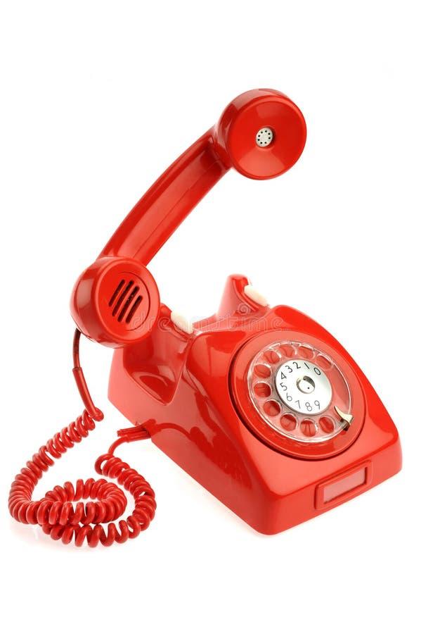 Altes Telefon über weißem Hintergrund lizenzfreies stockfoto