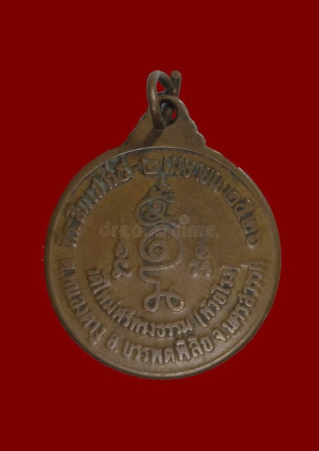 Altes thailändisches Amulett stockfoto