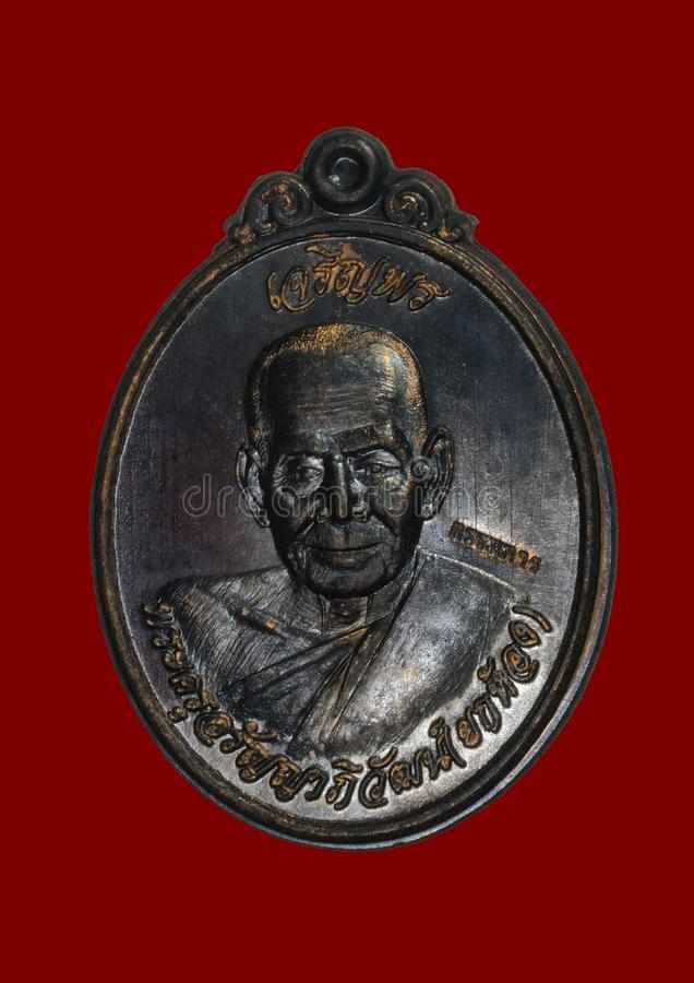 Altes thailändisches Amulett stockbilder