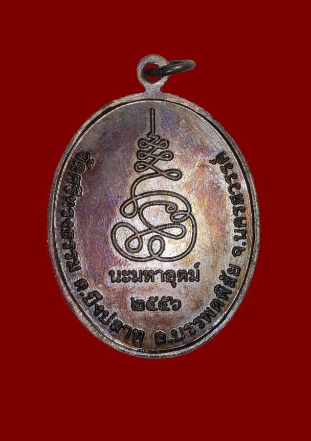 Altes thailändisches Amulett stockfotografie