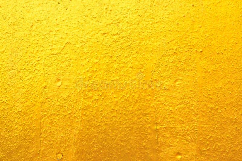 Altgold-Betonmauer lizenzfreie stockfotografie