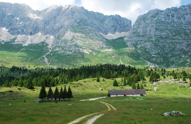 Altiplano de Montasio. The rural mountainous landscape of the Altiplano de Montasio in the Friulian Alps in north east Italy. Small farm building can be seen in stock images