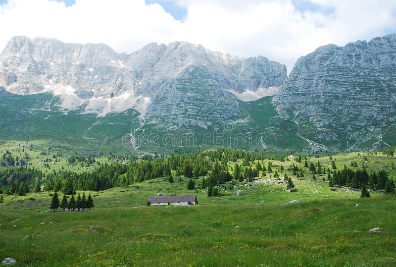 Altiplano de Montasio. The rural mountainous landscape of the Altiplano de Montasio in the Friulian Alps in north east Italy. Small farm building can be seen in royalty free stock images
