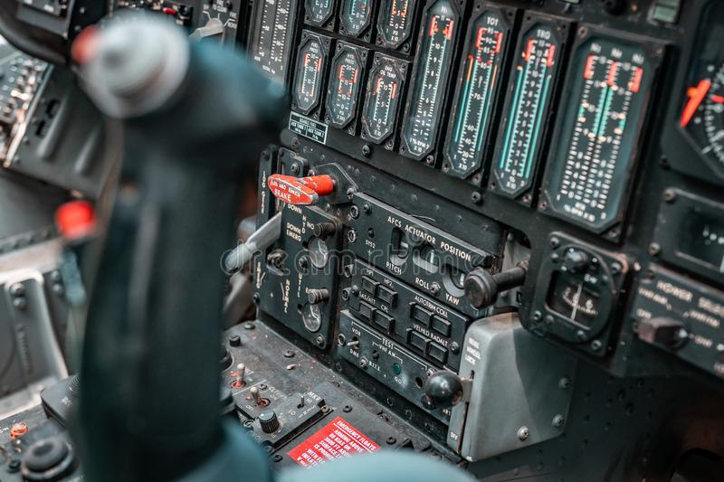 Details of control panel in military helicopter cockpit. Altitude and other major instruments on the panel of a military cockpit. Black metal frames and glowing royalty free stock images