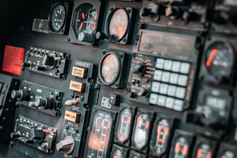 Details of control panel in military helicopter cockpit. Altitude and other major instruments on the panel of a military helicopter`s cockpit. Black metal frames royalty free stock image