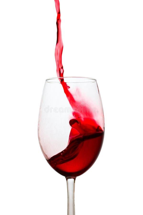 Alto getto di spruzzata luminosa del vino rosso immagini stock libere da diritti