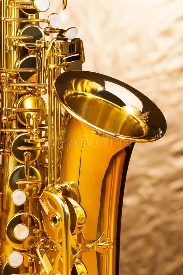 Alto saxophone with keys on silver background royalty free stock images