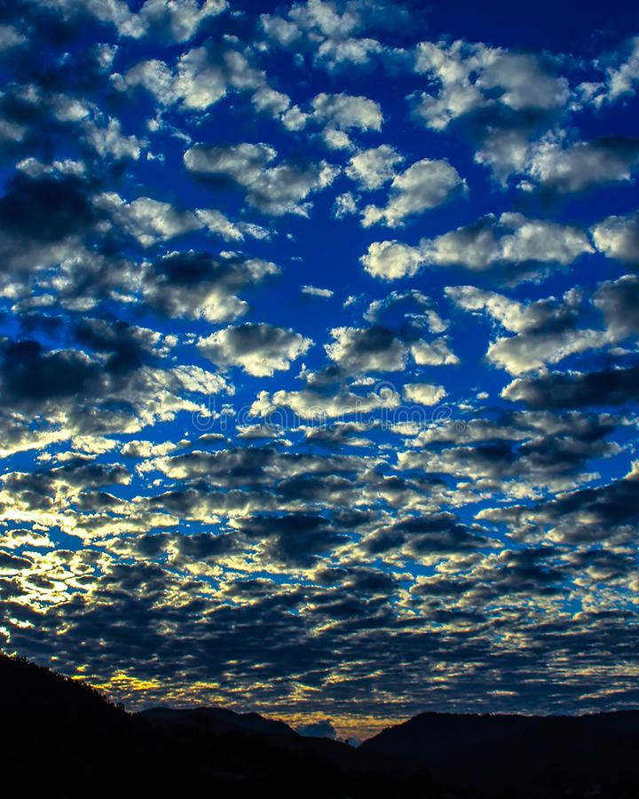 Altocomulus at sunset. A altocumulus or altocumulus is a class cloud characterized by globular masses or layered or patched windings, the individual elements are stock photography
