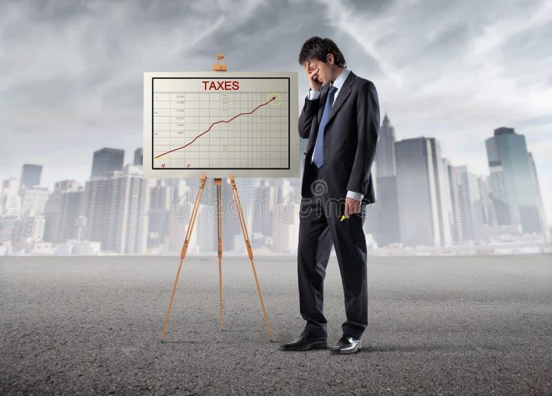 Altos impuestos foto de archivo