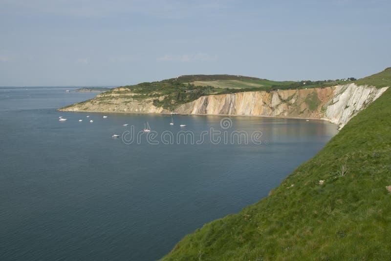 Alum Bay, Isle of Wight. Pleasure boats and cliff face Alum Bay, Isle of Wight royalty free stock images