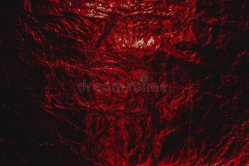 Aluminio arrugado extracto infernal rojo del grunge, fondo de la hoja de Halloween imagen de archivo libre de regalías