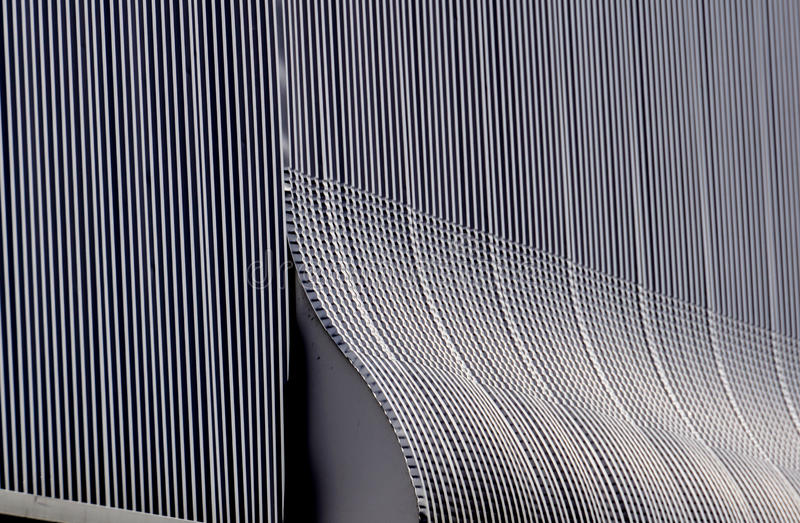 Aluminium architecture wall design pattern with light and shadow. Black and white aluminium architecture wall design pattern with light and shadow stock photography