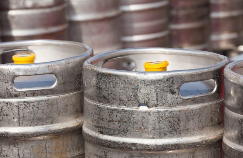 Aluminium beer kegs. In rows outdoor stock photography