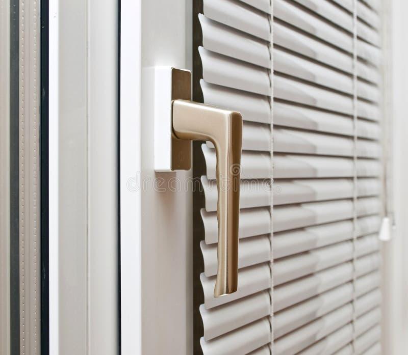 Aluminium blinds. On the plastik window stock photo