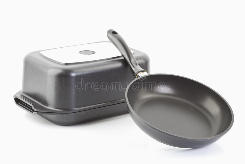 Aluminium cast frying pans stock photography