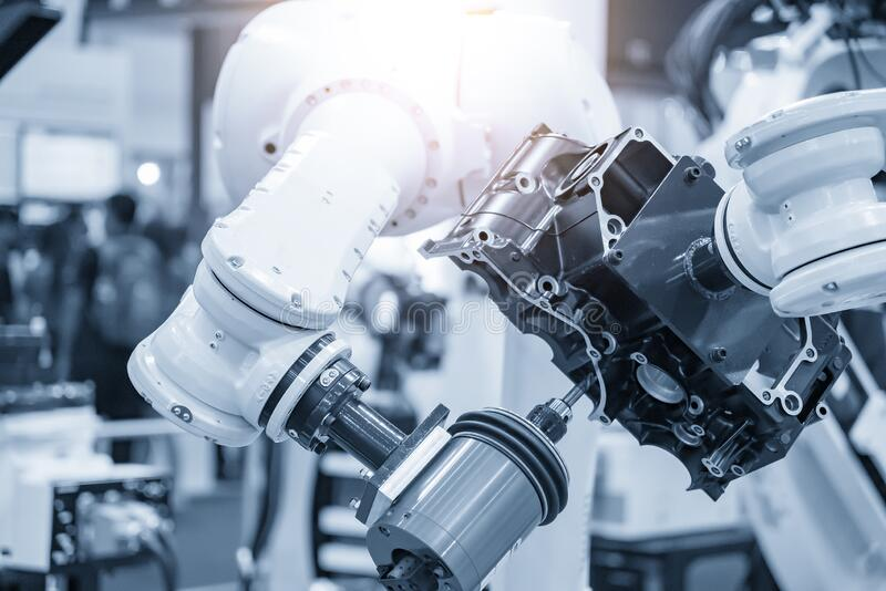 Aluminium casting gearbox part milling finishing  by milling spindle attach with the robotic arm. The automotive part manufacturing process by automatic royalty free stock image