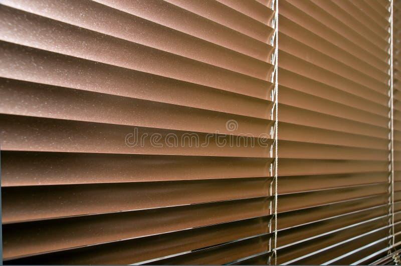 Aluminium colorized blinds on plastik window royalty free stock images
