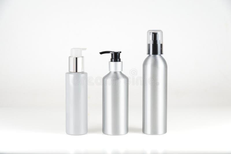 Aluminium cosmetic dispenser bottles and cartridges. On white background royalty free stock photos