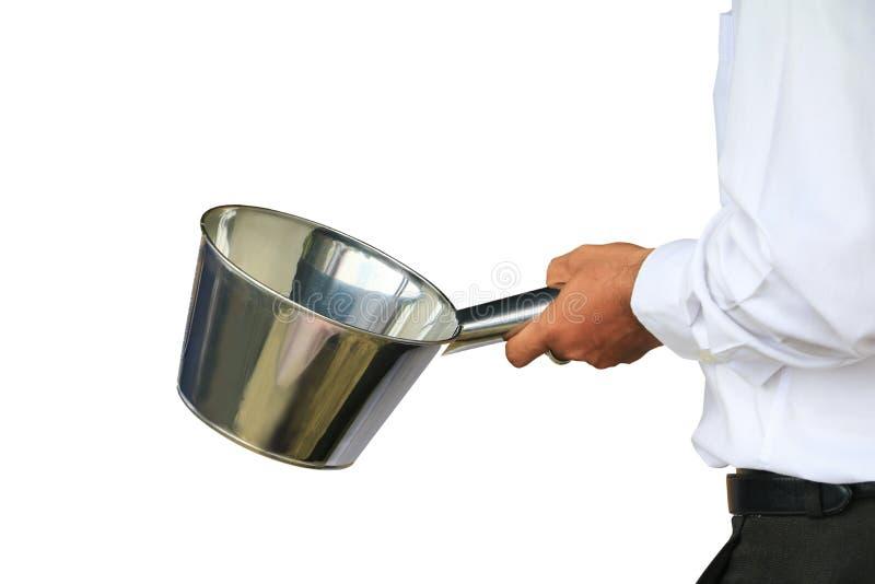 Aluminium för kruka för kockhandinnehav i att förbereda matbegreppet som lagar mat handling som isoleras på vit bakgrund fotografering för bildbyråer