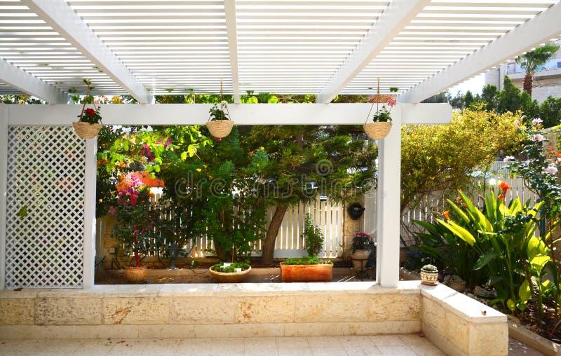 Aluminium pergola stock image image of garden courtyard for Zero maintenance garden