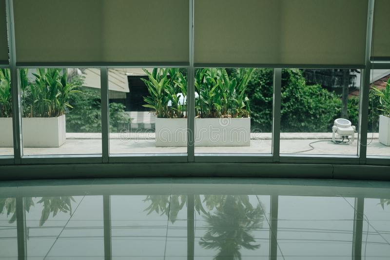 Aluminium window & white roll blinds roller curtain. For sun protection royalty free stock images