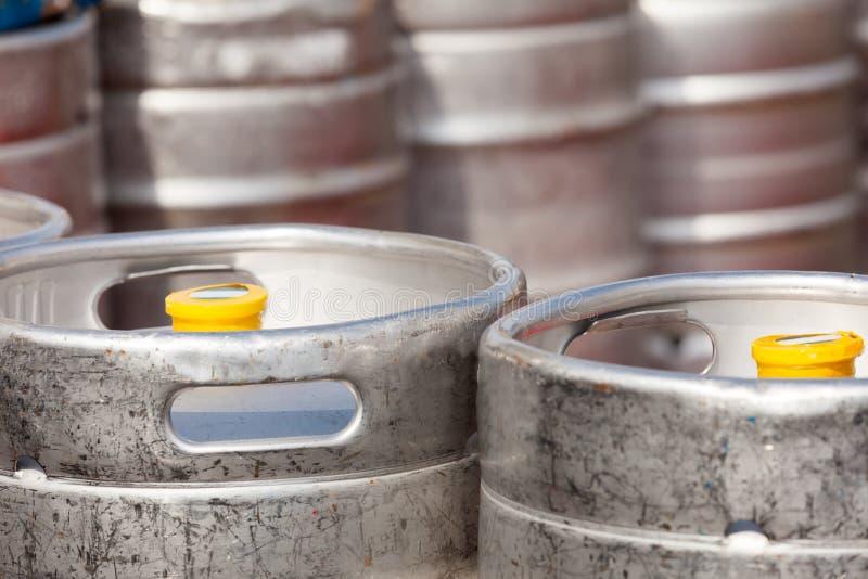 Aluminum barrel beer kegs. In rows outdoor royalty free stock image