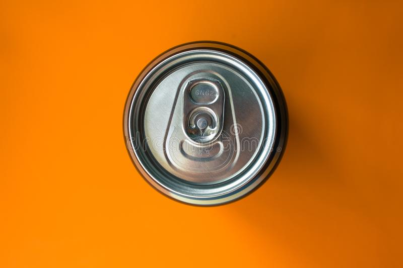 Aluminum can on an orange surface royalty free stock photo