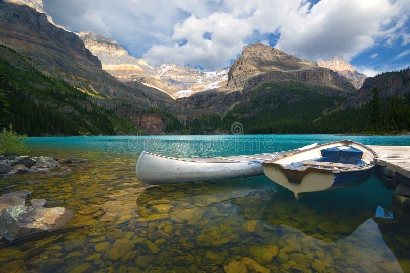 Aluminum canoe and a boat stock photos