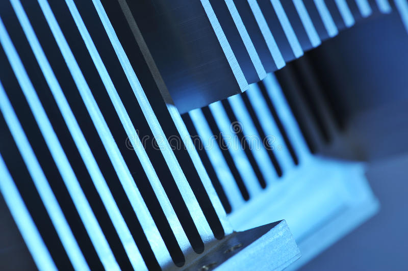 Aluminum cooling plate. Stylised industrial background - showing detail of an CNC manufactured aluminum cooling plate stock photo