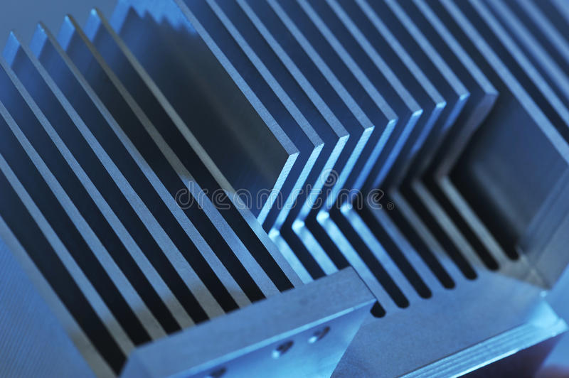 Aluminum cooling plate. Stylised industrial background - showing detail of an CNC manufactured aluminum cooling plate royalty free stock image