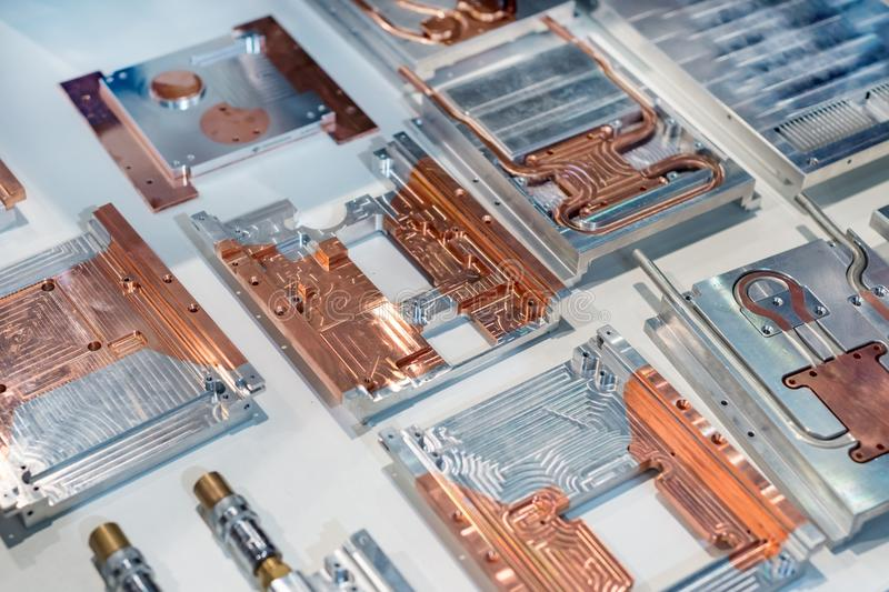 Aluminum-copper heat sink plates for industrial electronics. stock image
