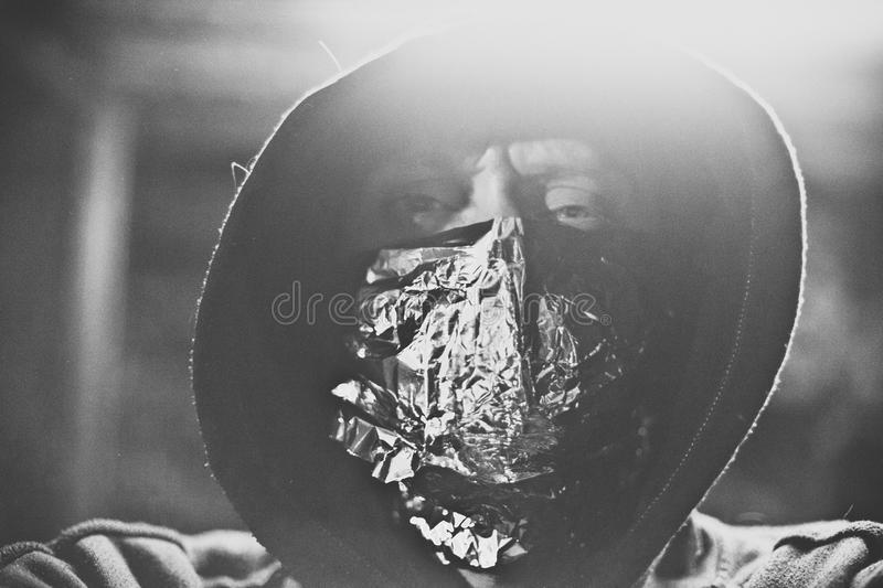 Aluminum face. Face cover with aluminum foil royalty free stock photography