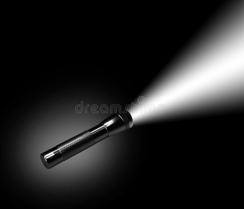 Aluminum flashlight in night stock photo