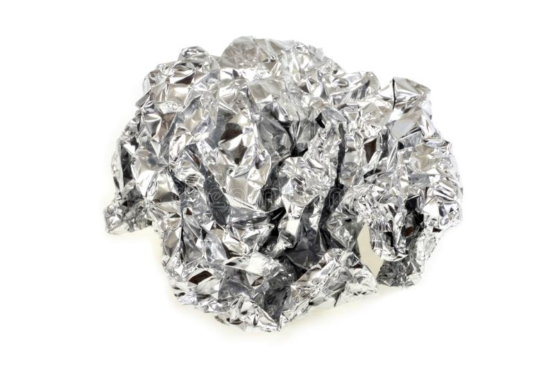 Aluminum foil rolled into a ball. Close up on aluminum foil ball on white background royalty free stock photography
