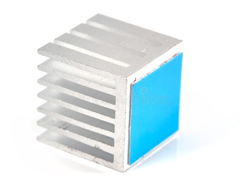 Aluminum heatsink. Small aluminum heat sink with blue adhesive tape, isolated on white royalty free stock photography