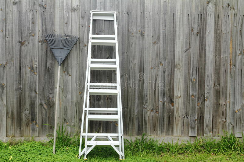 Aluminum ladder against the wall. stock photo