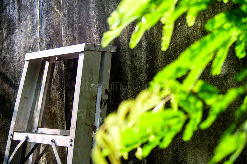 Aluminum ladder Leaning on the wall royalty free stock photos