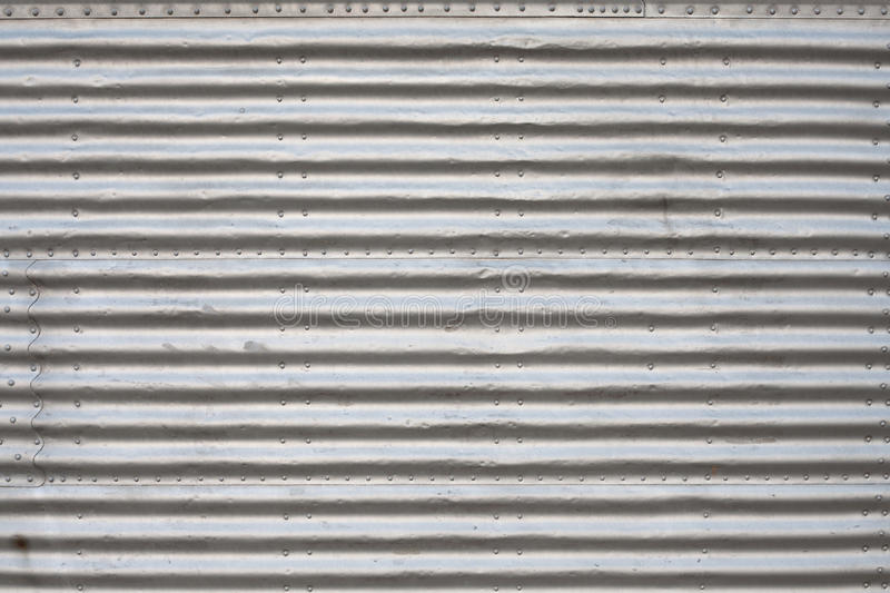 Aluminum panel. Gray aluminium rippled panel stock photo