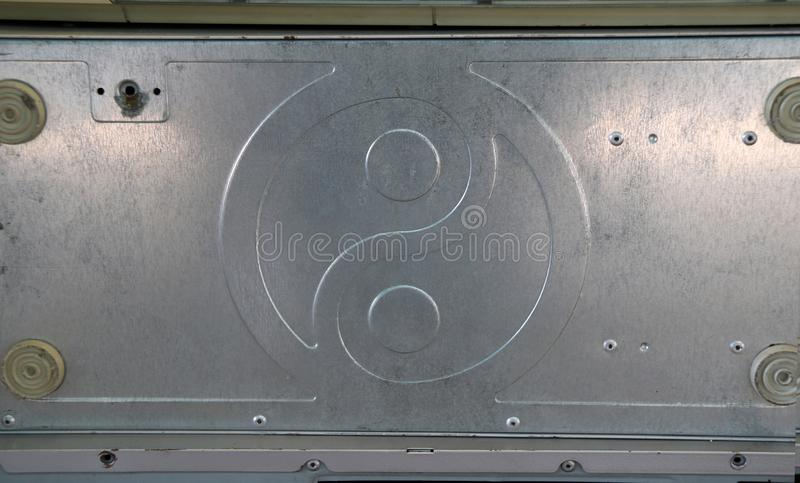 Aluminum plate pattern of yin yang. It is the part of computer case. stock photography