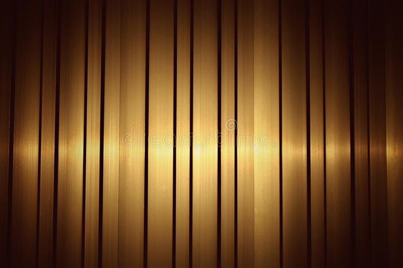 Aluminum, stainless steel yellow gold have a stacked sheet. With a golden light in the landscape for background - image royalty free stock image