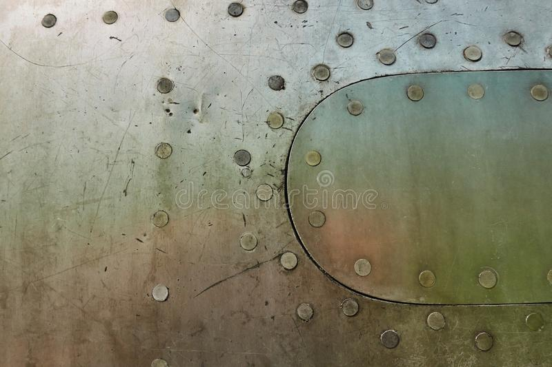 Aluminum surface of the aircraft fuselage. Smooth rows of rivets, there are scratches, dirt royalty free stock images