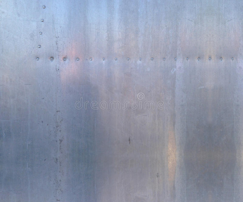 Aluminum texture. Vintage aluminum, vintage trailer, airstream metal with rivets stock photos