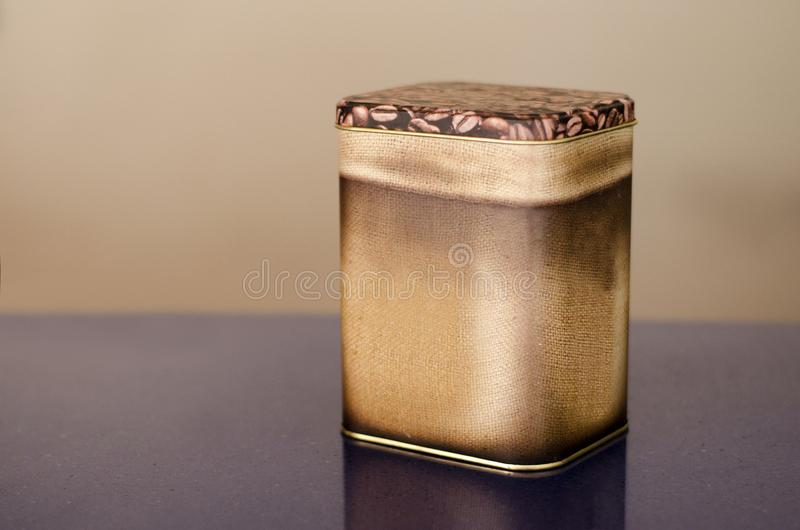 Aluminum Tin Can painted with coffee granules on brown background Canned packaging for coffee or tea, gift box. 3d rendering stock illustration