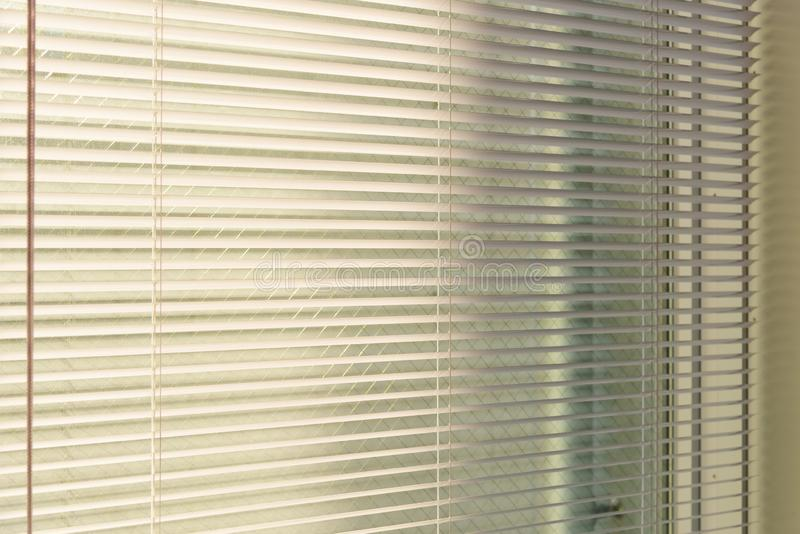 Aluminum venetian blinds with sunlight coming from a window. decoration interior stock image