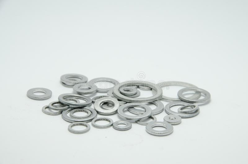 Aluminum washers. Aluminum, washers,washers for carter,screws for car royalty free stock image